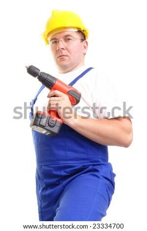 Construction worker wearing blue overall and yellow helmet holding cordless drilling machine over white background