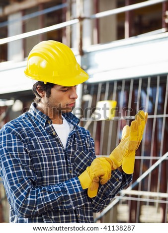 construction worker wearing protective gloves. Side view - stock photo