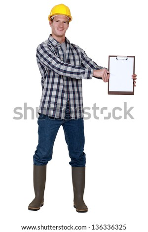 Construction worker with a blank clipboard