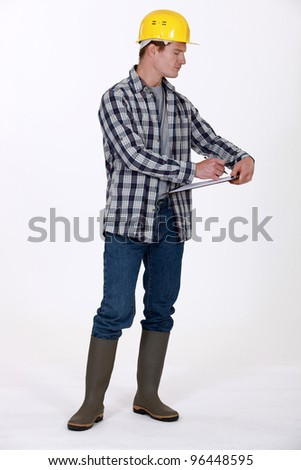 Construction worker with a clipboard - stock photo