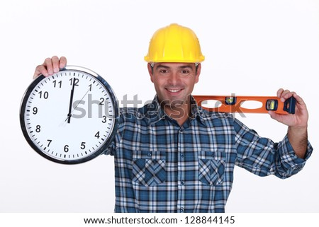 Construction worker with a clock - stock photo