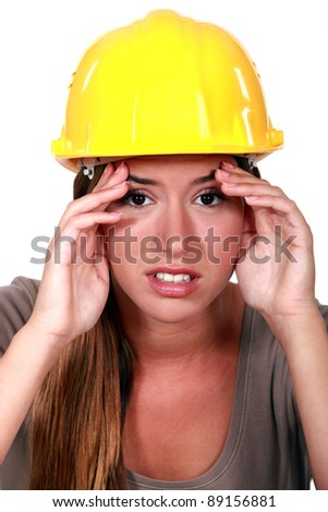 Construction worker with a headache