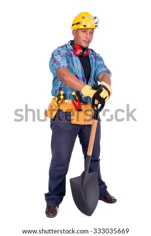 Construction worker with a shovel isolated in white - stock photo