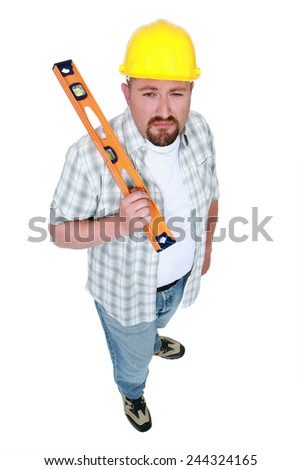 Construction worker with a spirit level - stock photo