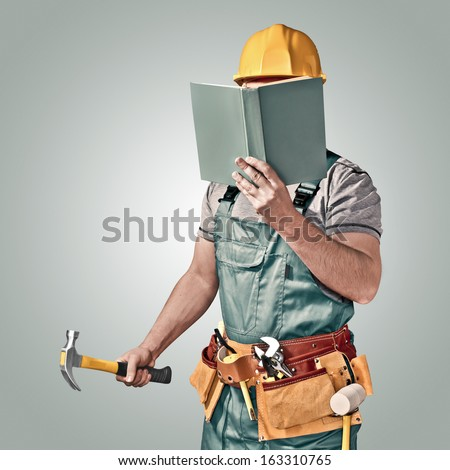 construction worker with a tool belt and book - stock photo
