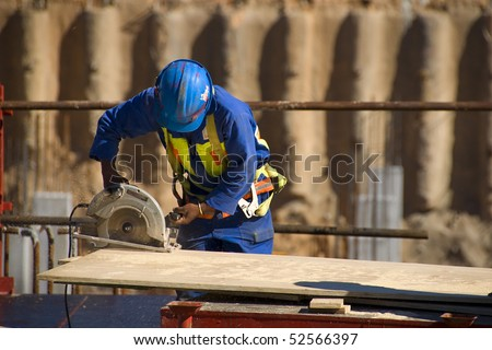 Construction worker with and electric saw