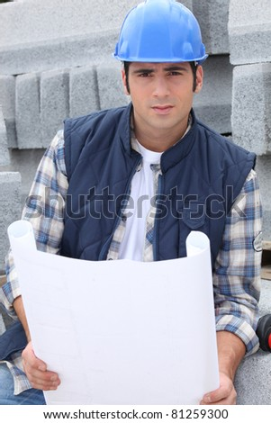 Construction worker with building plans - stock photo