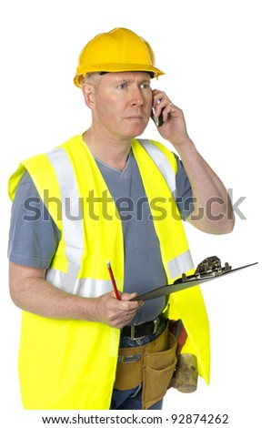 Construction worker with clipboard on white background takes call - stock photo