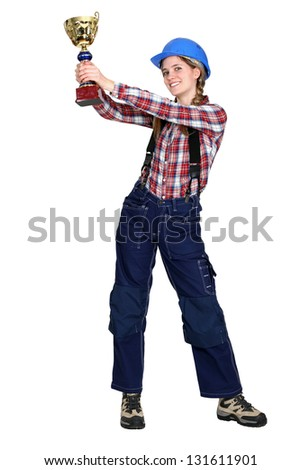 Construction worker with gold cup - stock photo