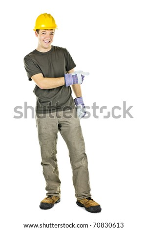 Construction worker with hard hat pointing to the side isolated on white background - stock photo