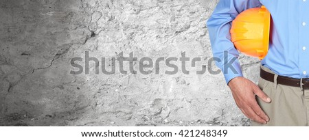 Construction worker with helmet. - stock photo