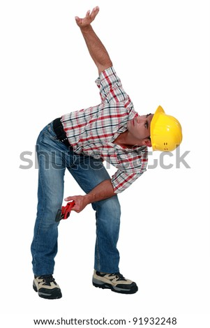 Construction worker with his arm up - stock photo