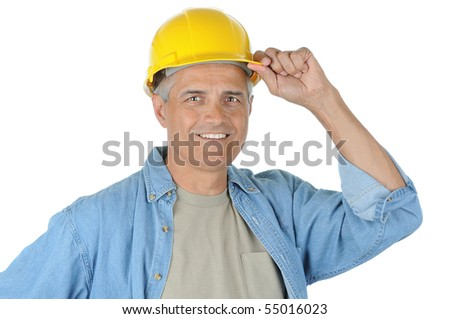 Construction worker with his hand on hard hat brim, isolated on white in vertical format. - stock photo