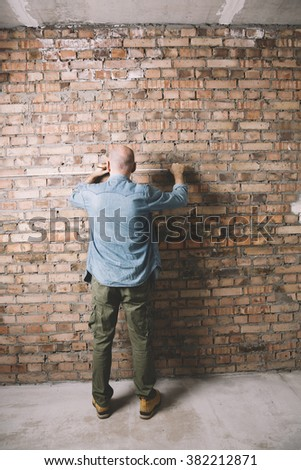 Construction worker with measuring tape - stock photo