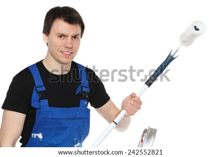 construction worker with paint roller - stock photo