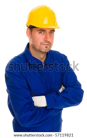 Construction worker with safety suit and gloves with yellow safety hat looks into the camera, isolated on white - stock photo