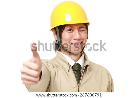construction worker with thumbs up gesture - stock photo