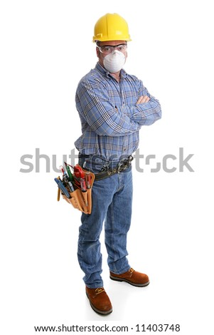 Construction worker with tools and safety gear, including hardhat, goggles and dust mask.  All equipment depicted is accurate in accordance with industry safety standards. - stock photo