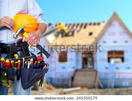 Construction worker with  tools in  new house. Renovation. - stock photo