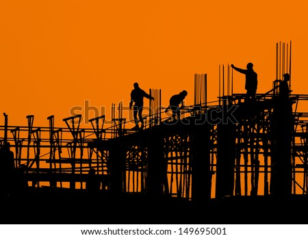 Construction worker working on a construction site - stock photo