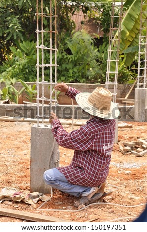 Construction workers are building the foundations - stock photo