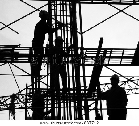 Construction Workers as a Silhouette -- high up on the scaffolding