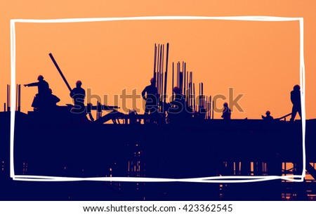 Construction workers at sunset.