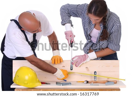 construction workers at work on white background