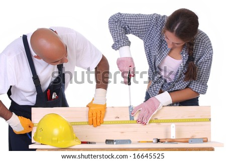 construction workers at work on white background - stock photo