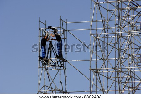 Construction workers building a new structure in city - stock photo