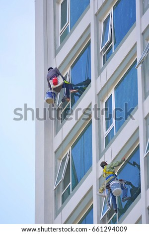 Construction workers in high rise building