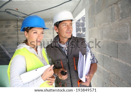 Construction workers on building site - stock photo