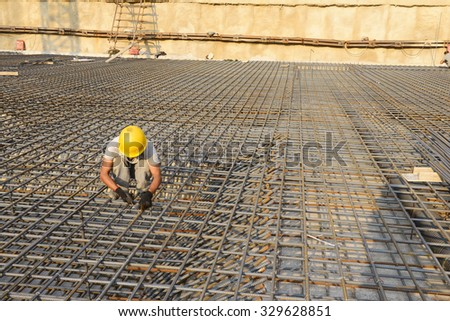 Construction workers on the construction site  - stock photo