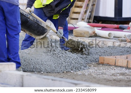 Construction workers pumping - stock photo