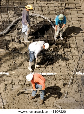 Construction workers pumping cement in Honolulu Hawaii. - stock photo
