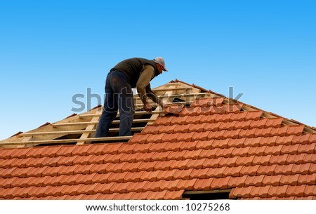 construction workers reapiring roof - stock photo