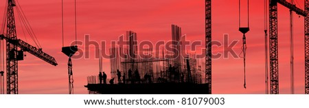 Construction workers silhouette against the sunset., panorama