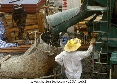 Construction workers with cement in Hong Kong - stock photo
