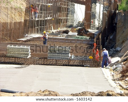 Construction workers working with underground tunnel structure - stock photo