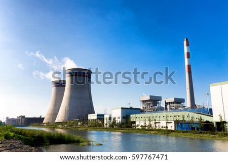 constructions in modern power plant near river