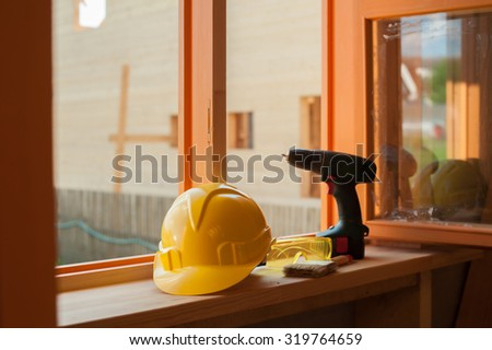 constructions site with helmet and instruments - stock photo