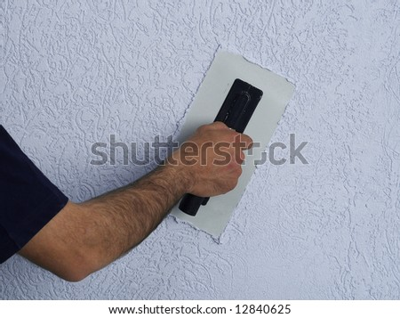 Constructor Redecorating The House Walls