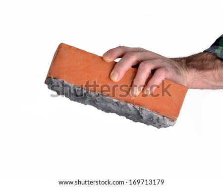 Constructor worker holding a cement construction brick. - stock photo
