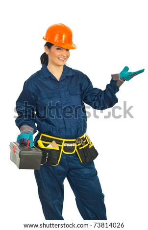 Constructor worker making presentation and holding a tools container isolated on white background