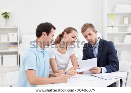 Consultant demonstrates a couple of documents - stock photo