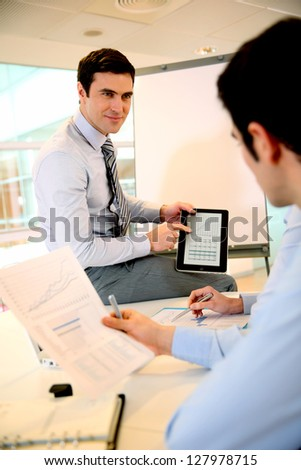 Consultant doing business conference - stock photo