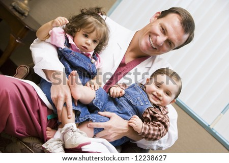 Consultant holding IVF conceived children - stock photo