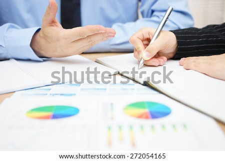 Consultant is explaining solutions to his client - stock photo