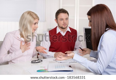 Consultation at office with couple and consultant.  - stock photo