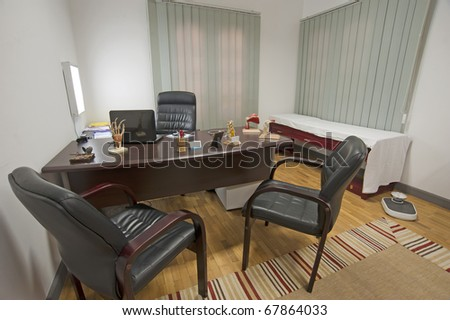 Consultation room in a doctors surgery with examination bed - stock photo